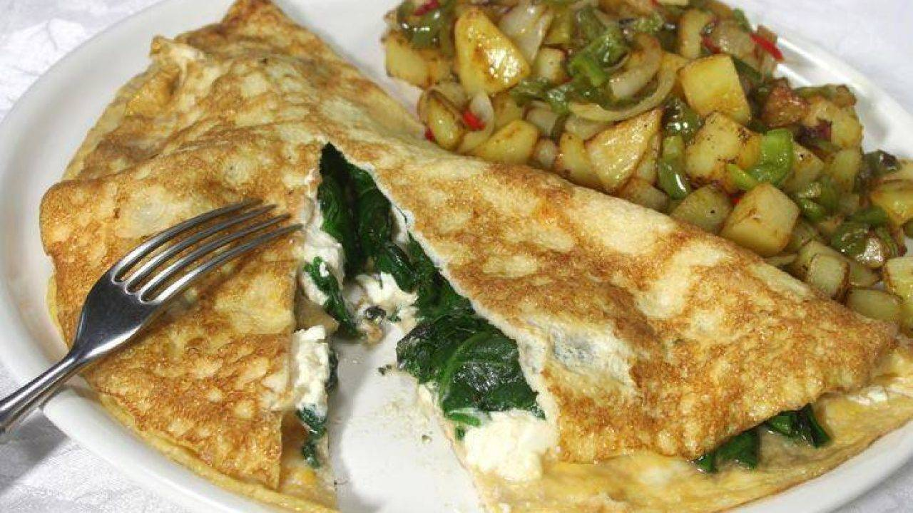 Ricetta Omelette Ricotta E Spinaci.Omelette Ripiena Di Spinaci E Mozzarella Cremosa E Filante