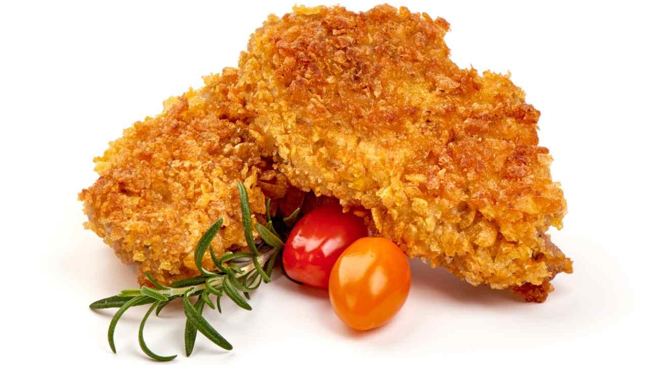 Petti di pollo al forno con curry e corn flakes