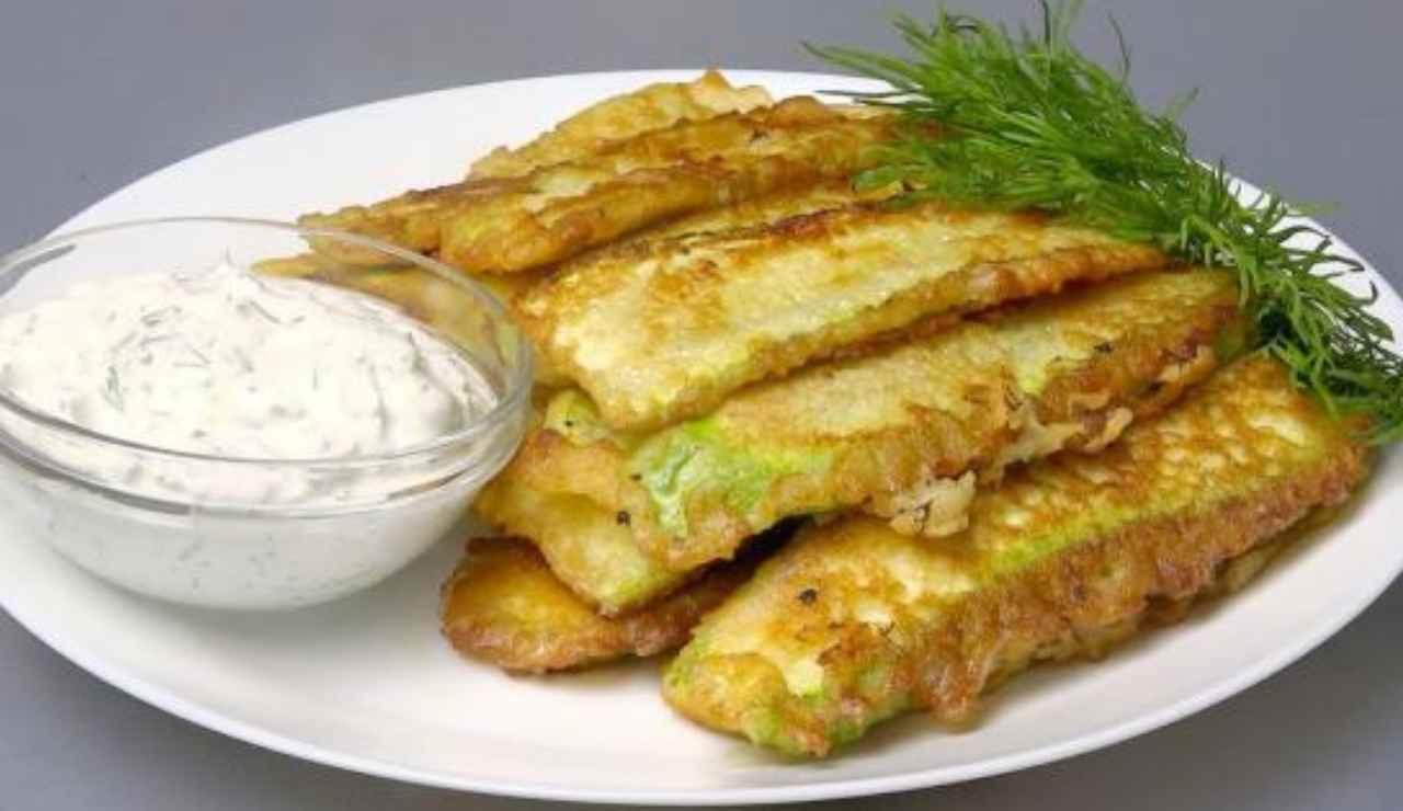 Zucchine profumate e infarinate al forno