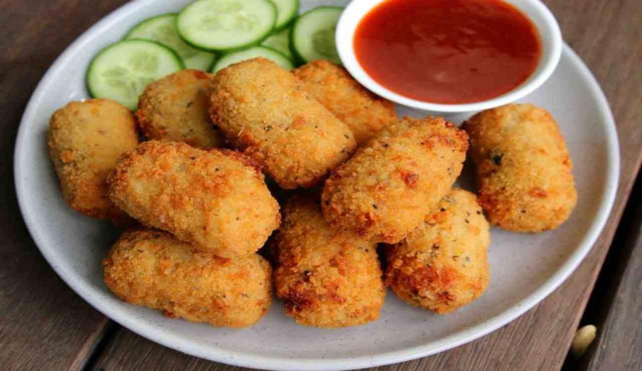 Bastoncini di pollo filanti con verdure