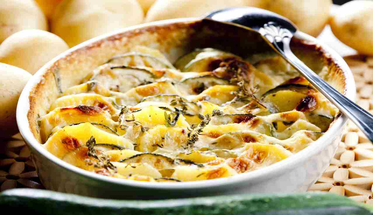 Parmigiana con besciamella bacon patate e zucchine