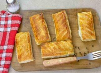 Pasta sfoglia ripiena di prosciutto cotto e formaggio filante